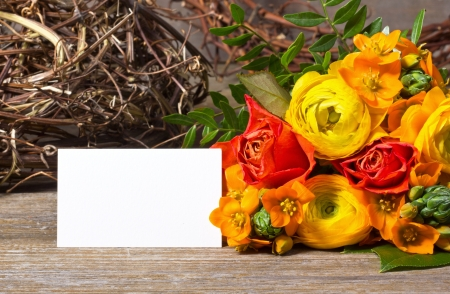 flowers and white card on wooden ground Stock Photo - 18217390