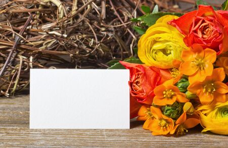 flowers and white card on wooden ground Stock Photo - 18217388