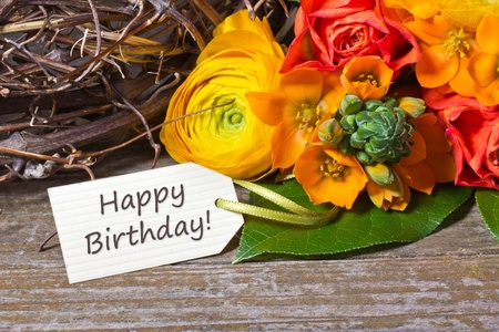 flowers and white card with lettering happy birthday Stock Photo - 18304766