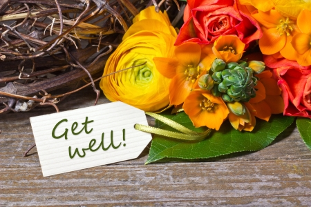 flowers and white card with lettering get well Stock Photo - 18304765
