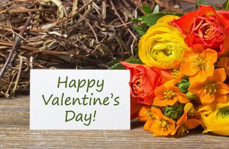 flowers and white card with lettering Happy valentine s day photo