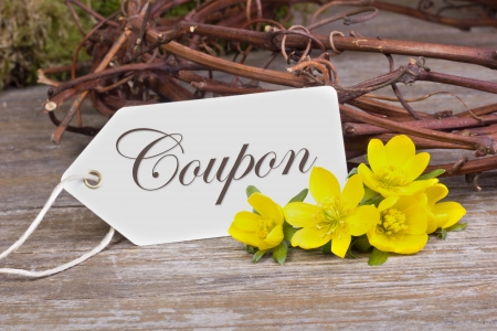 yellow blossoms and white card  with lettering voucher photo