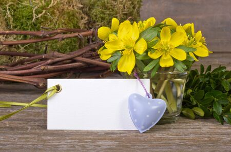 early blossoms: yellow flowers, twigs, hearts and white card