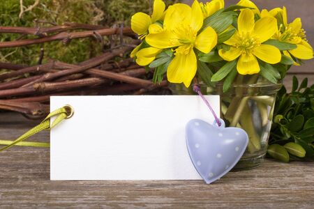 yellow flowers, twigs, hearts and white card Stock Photo - 18350018