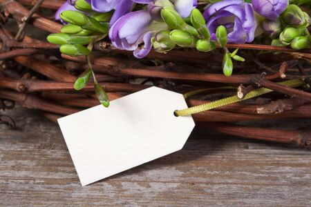 Freesias, twigs and card Stock Photo - 18498063