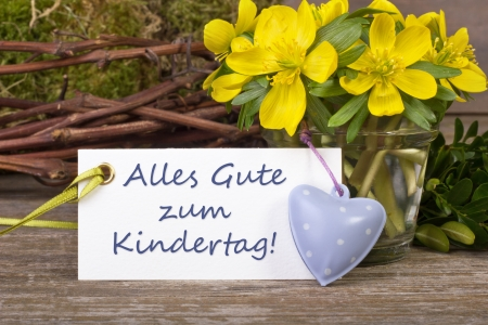 yellow flowers, twigs, heart and children s day card photo