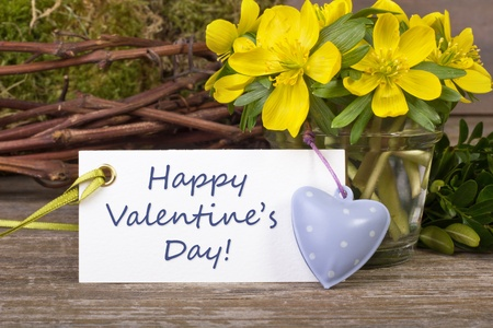 yellow flowers, twigs, hearts and Valentin s day card photo