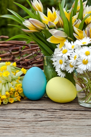 early blossoms: tulips, daisies and easter eggs