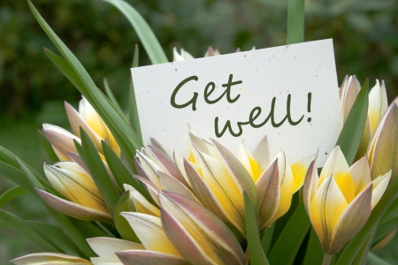 yellow tulips and card with lettering get well photo