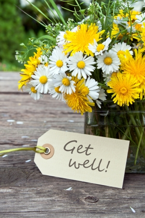 get well: wild flowers and label with lettering get well Stock Photo