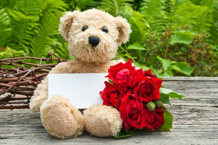 teddy wreath: teddy bear with red roses Stock Photo
