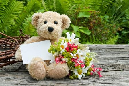 teddy wreath: teddy bear with flowers and card