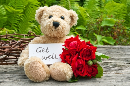 get well: teddy bear with red roses  and card with lettering get well