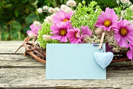pink flowers with card and heart