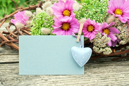 pink flowers with card and heart photo