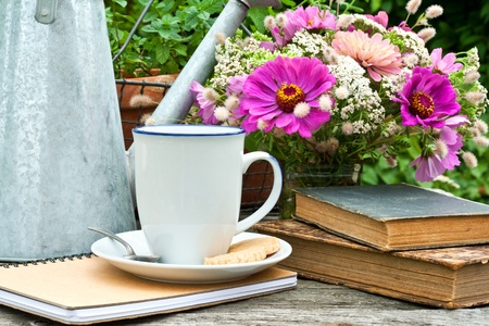 afternoon break: coffee mug, watering can, straw hat and flowers
