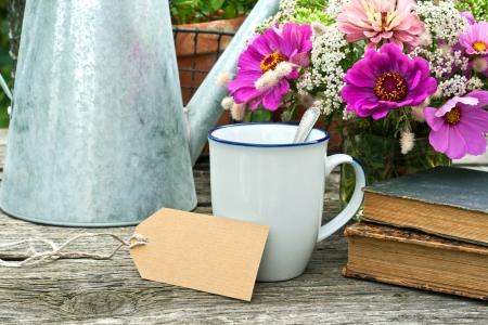 coffee hour: coffee mug old books and flowers