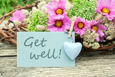 pink flowers with card get well