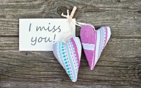 i miss you: Two hearts and card with lettering I miss you