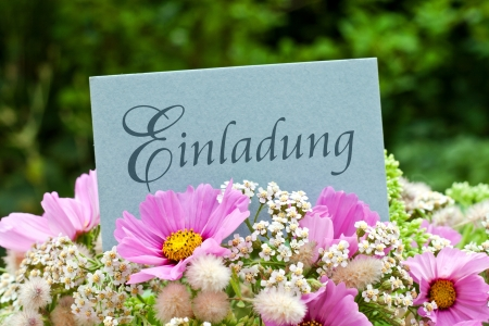 pink flowers and card with invitation photo