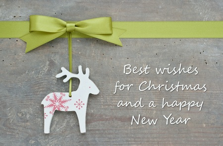 christmas card with reindeer and green bow