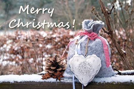 christmas card with santa bag and heart