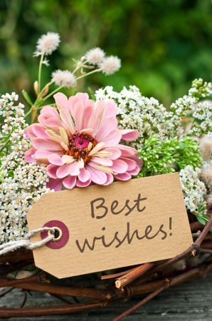 best wishes: Flowers and card with lettering best wishes