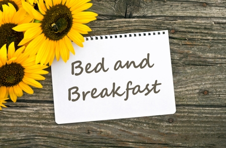 Sunflower and card with lettering bed and breakfast Stock Photo - 23638876