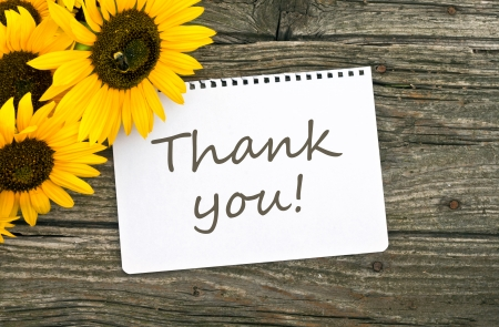 Sunflowers and card with lettering thanks