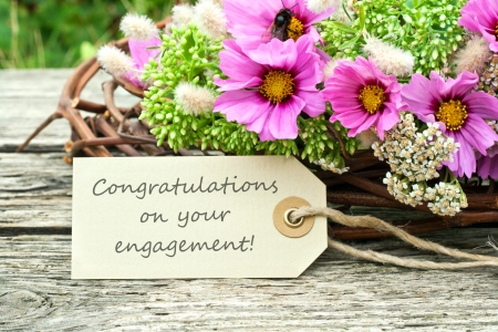 pink flowers with card to engagement