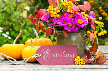 Flowers, pumpkins and card with lettering invitation photo