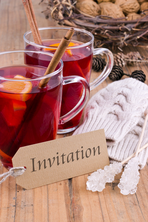 Fruit tea with orange and card with lettering invitation
