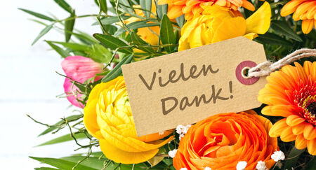 bouquet with gerbera, buttercups  and anemones with card photo