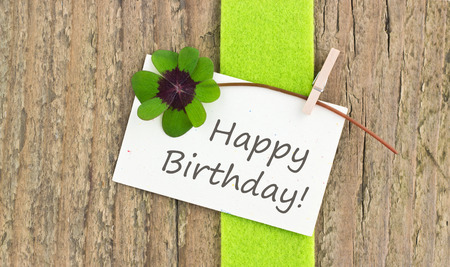 leafed: Birthday card  with leafed clover