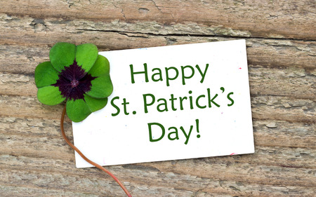leafed: St  Patrick s day card with leafed clover Stock Photo