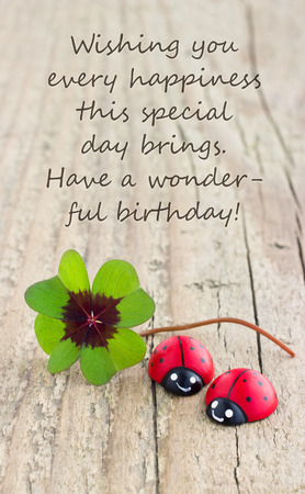 Birthday card with leafed clover and ladybugs
