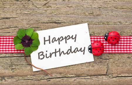 leafed: Birthday card with leafed clover and ladybugs