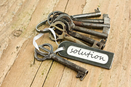 bunch of keys and label with lettering solution Stock Photo