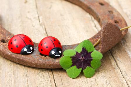 horseshoe with ladybugs and lucky clover photo