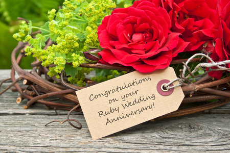 anniversary wishes: Ruby Wedding Anniversary card with red roses Stock Photo