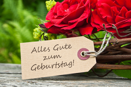rosas rojas: tarjeta de cumplea�os con rosas rojas Foto de archivo
