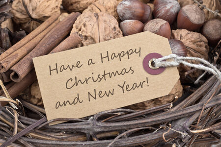 Christmas card with nuts, cones and cinnamon Stock Photo