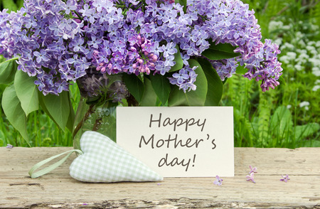 white card: Mother s day card with Bouquet of lilac Stock Photo