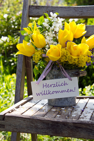 warmest: yellow tulips and Welcome card Stock Photo