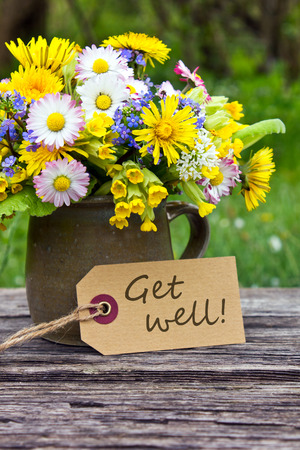 get well: english Get well card with spring flowers Stock Photo