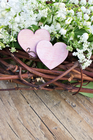 Two hearts with Lily of the valley and lilac Standard-Bild
