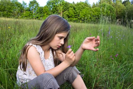 bellflower: Young girl with bellflower