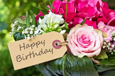 engels verjaardagskaart met roze bloemen Stockfoto