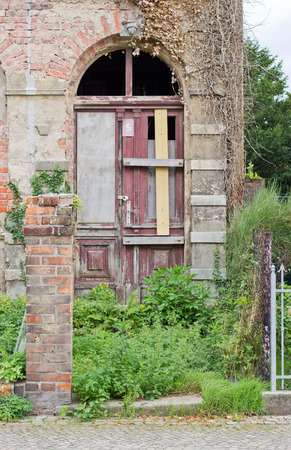 tumble down: Old, derelict house with wild plants