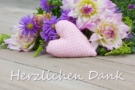 German greeting card with flowers and heart photo